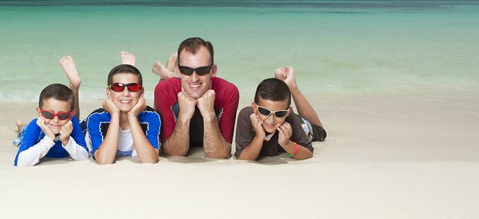 Father with his children at the beach