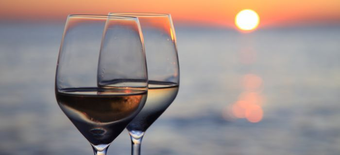 Two glasses of wine against the sunset
