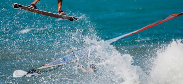 Kitesurfer and Windsurfer together on the water