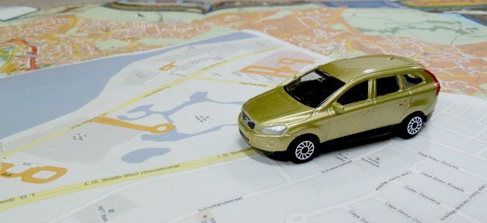 A toy placed on a road map of Aruba