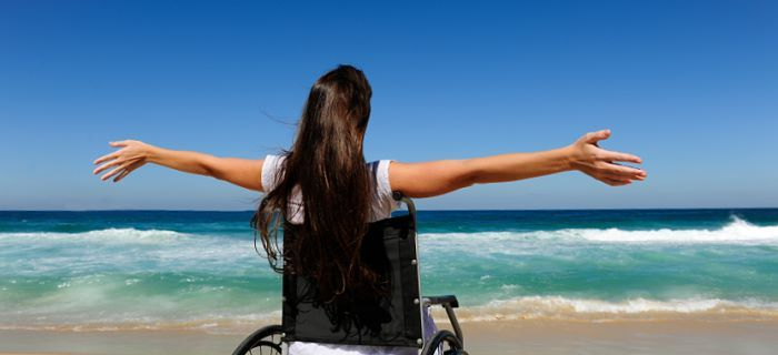 with a wheelchair on the beach